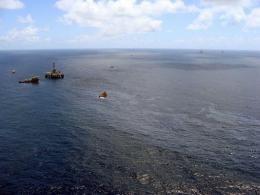 Supply boats cleaning an oil spill around a Chevron platform operating in the Frade oil field