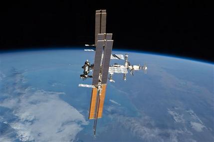 Spacewalking astronauts nix release of satellite (AP)