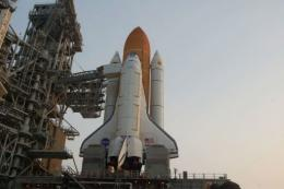 The space shuttle Atlantis is seen on the launch pad at Kennedy Space Center