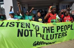 Greenpeace activists demonstrate at the climate change talks in Durban