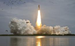 US space shuttle Atlantis is shown launching for the final flight of the shuttle program
