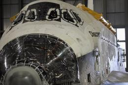 Space Shuttle Discovery is readied for transport to Washington, DC's National Air and Space museum