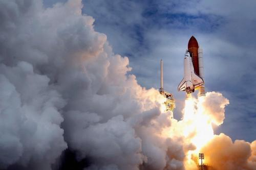 Space shuttle Atlantis blasts off from launch pad 39A at Kennedy Space Center, on July 8