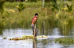 A boy wading through flood water in Cotabato city, southern Philippines
