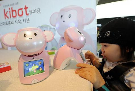 A child plays with a robot entitled