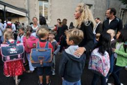 Adults accompany children to school