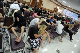 A group of 177 arrested Taiwanese and Chinese nationals are held at the Indonesian immigration building in Jakarta