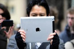 A man test the latest iPad 2