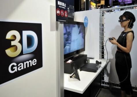 A model demonstrates a 3D videogame content for the PlayStation 3 videogame console at the Tokyo Game Show in Chiba city