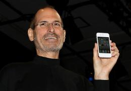 Apple CEO Steve Jobs holds the iPhone 4
