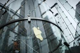Apple shares hit a record high on Wall Street ahead of what is expected to be another blockbuster earnings report