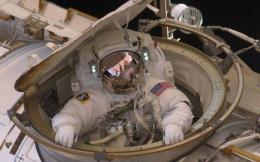 Astronaut Drew Feustel re-enters the space station after completing an 8-hour, 7-min spacewalk