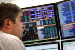 A trader monitors the markets