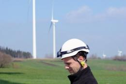 A Vestas engineer at work neat wind turbines at Salles-Curan, central France