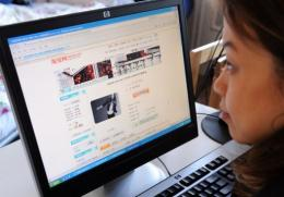 A woman in Beijing shops online at the Taobao website