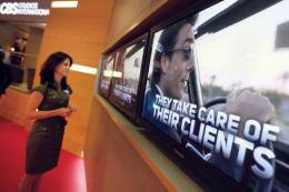 A woman watches screens  in Cannes, southern France, during the MIPTV trade show