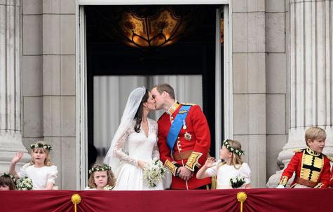 Britain's Prince William and his wife Kate, Duchess of Cambridge kiss