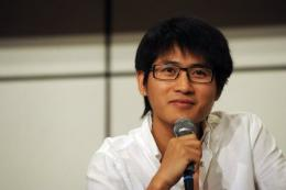 Chinese writer and blogger Han Han speaks during a press conference at a book fair in Hong Kong