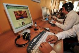 Computer users are pictured in an Internet cafe in Istanbul
