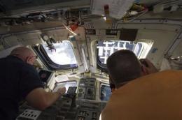 Endeavour astronauts stroll out for spacewalk (AP)