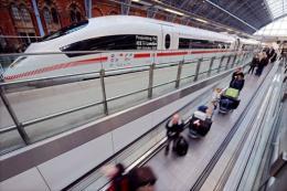Eurostar passengers pass an ICE high speed train operated by German rail firm Deutsche Bahn