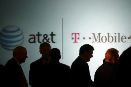 Executives at AT&T attend a news conference where it was announced that AT&T Inc. will be buying T-Mobile USA