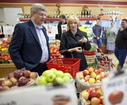 Harper and his wife shop during a campaign