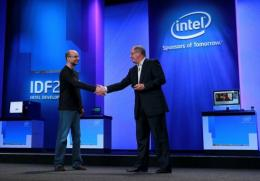 Intel CEO Paul Otellini (R) shakes hands with Google Senior VP of Mobile Andy Rubin