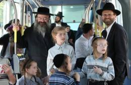 Israelis enjoy a ride as Jerusalem's light rail system begins operating in central Jerusalem today