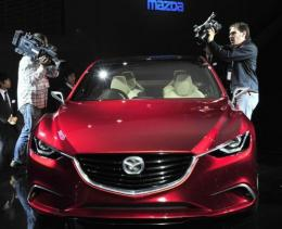Japan's auto giant Mazda Motor displays the concept mid-sized sedan