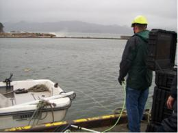 Japan, U.S. team deploys underwater robots to coast