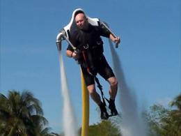 Jet-pack man soaring above California waters