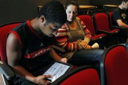 Many US schools adding iPads, trimming textbooks (AP)