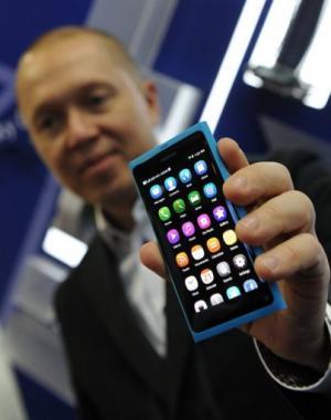 Marko Ahtisaari displays a Nokia N9 smartphone