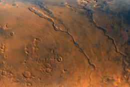 Martian water vs. the volcanoes