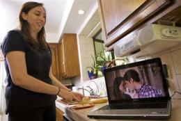 More ads hit online TV as Web audiences grow (AP)