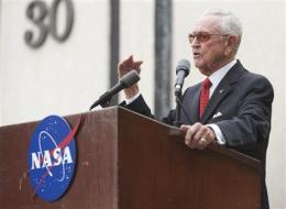 NASA pioneer honored; says he regrets shuttle end (AP)
