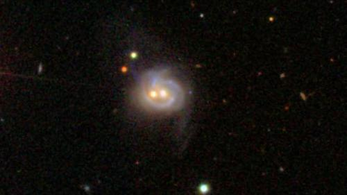 Nearby galaxy boasts 2 monster black holes, both active