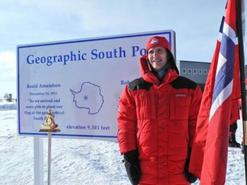 Norwegian Prime Minister Jens Stoltenberg stands at the geographic South Pole