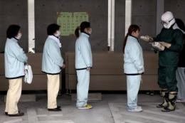 People line up for radiation screening at Koryama in Fukushima prefecture in March