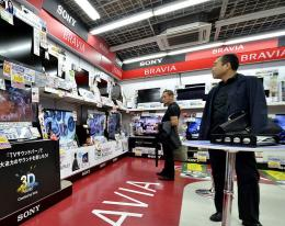 People look at Sony electronic products at an electrical shop in Tokyo on May 26