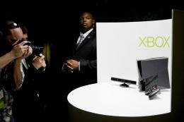 Photographers take pictures of the Kinect peripheral and the Xbox 360 console