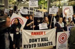 Protesters demonstrate against the possible end of the Kyoto Protocol in 2009