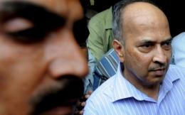 Reliance ADA Group Managing Director Gautam Doshi leaves after an appearance in a New Delhi court