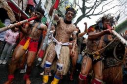 Representatives of indigenous tribes carry out a demonstration in Sao Paulo against the construction of Belo Monte dam