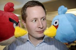 Rovio CEO Mikael Hed poses with two