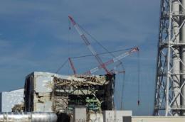 The crippled Fukushima Daiichi nuclear power station is seen through a bus window