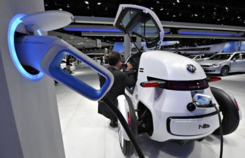 The electric Nils concept car by German car maker Volkswagen is connected to a charging station