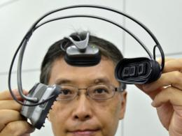 The equipment uses near-infrared light to detect the amount of blood in the brain