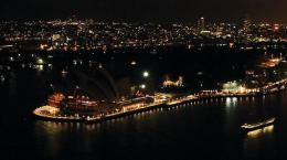 The lights around Sydney's Harbour and the iconic Opera House (L) turned off to mark